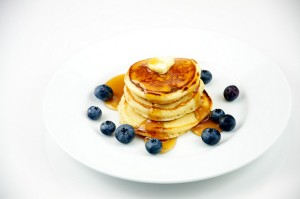 Silver Dollar Pancakes with Blueberries on a White Plate